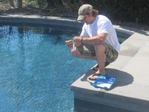 pool guy balancing pool chemicals